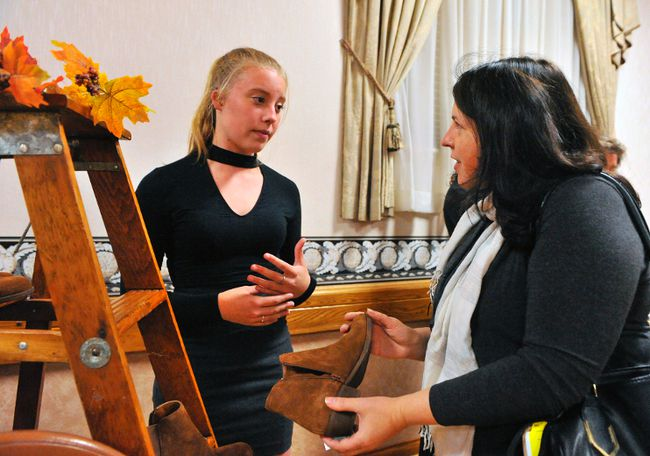 Zahyra Shurr, left, representing Main Station Apparels chats with Lorraine Skarratt during the Women in Business/Ladies Night Out gathering Wednesday at the Delhi German Home. More than 200 women attended the evening, which includes dinner, live entertainment and shopping. The event is sponsored by the Simcoe Reformer. JACOB ROBINSON/Simcoe Reformer