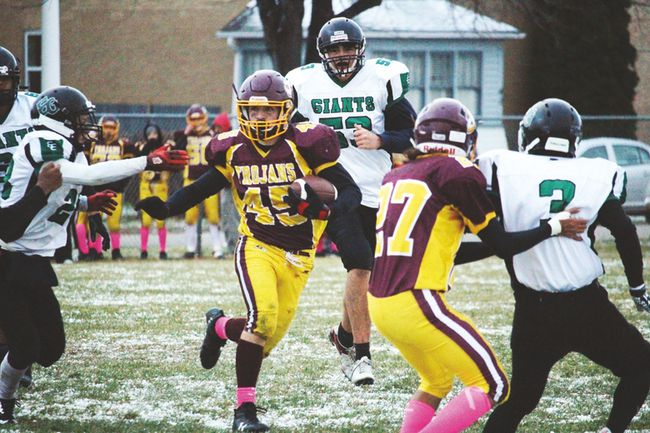 Trojans running back Brice Verwey scored two touchdowns and ran for over 100 yards in their 23-6 win over Elmwood in the WHSFL playoffs. (Aaron Wilgosh/The Graphic)