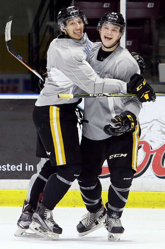 Jordan Kyrou, left, and Drake Rymsha enjoy a light moment during the Sarnia Sting's practice at Progressive Auto Sales Arena in Sarnia, Ont., on Wednesday, Oct. 25, 2017. (MARK MALONE/Postmedia Network)