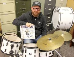 Stratford music teacher Isaac Moore holds a copy of Gord Downie's graphic novel Secret Path. After Downie's death last week, Moore started an online campaign, #TeachLikeGord, encouraging Canadian teachers to use the lyrics and messages of The Tragically Hip's lead singer to educate kids.