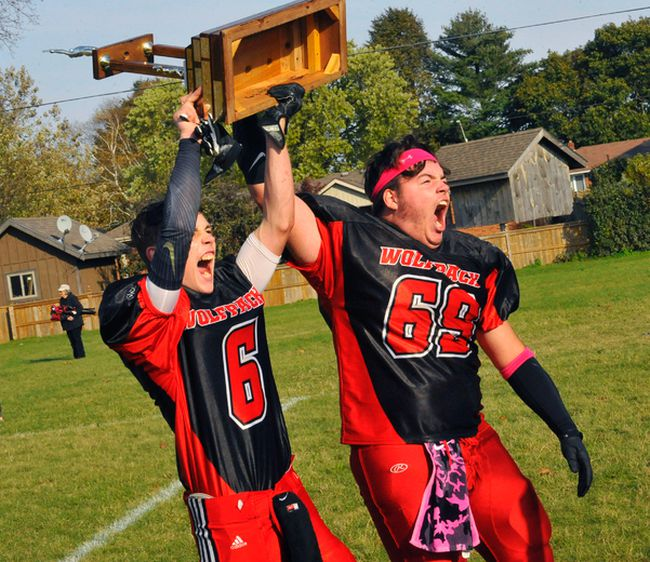 Waterford Wolves captains Ben Huffman and Tanner Wilson hoist the Norfolk Bowl trophy after defeating the Simcoe Sabres 24-21 in overtime of Friday's Haldimand-Norfolk semi-final at WDHS. The Wolves will move on to face McKinnon Park for the league championship Nov. 4.