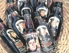 A basket of Martin Luther-branded liquor in Germany shows the lively side of the German monk who launched the Protestant Reformation 500 years ago Tuesday. (Eliot Stein/Special to the Washington Post)