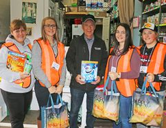 Students from École secondaire catholique Thériault and members of Projet Amour Communautaire (PAC) will be costumed in safety vests on Halloween night in Timmins as they go door-to-door collecting non-perishable food items for the Timmins Food Bank. This is the fourth year the ESCT students have been out in support of gathering food for needy families and individuals. Among those who will be taking part are, from left, PAC organizer Lyse Perron, student Reneé Viel, food bank president Rick Young, students Kara D'Arcangelo and Jaz Chartrand. The food drive will take place in most of the central area of Timmins and Mountjoy Township, from 5:30 p.m. to 7:30 p.m. Homeowners will notice that the students will all be wearing name tags. Food Bank president Rick Young said he was pleased to see the Thériault students being so generous with their time and said he was confident that homeowners would again be generous with food donations.