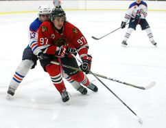 Brockville Braves Tyson Kirkby tries holding off Kanata Lasers Ryan Bunka during Friday's game at the Memorial Centre. (Jonathon Brodie/The Recorder and Times)