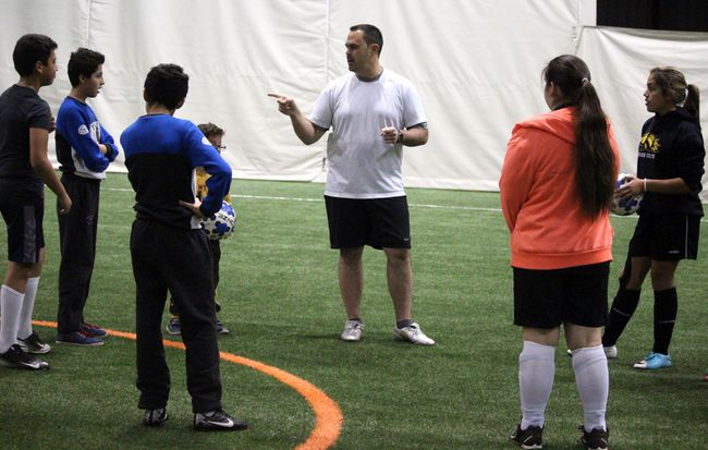 Sonny Spina speaks before the start of a soccer game bringing together newcomers to the city and Sault Ste. Marie youth at Northern Community Centre.