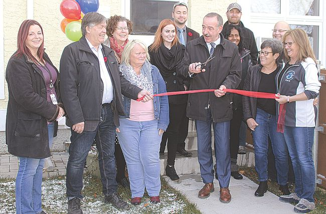A ribbon-cutting ceremony took place Friday afternoon outside of ROK's office in the Manitoba Housing unit on 11th St in Portage la Prairie. Individuals representing Manitoba Housing, ROK, the City and the Province were all on hand for the intimate reception.(Brian Oliver/The Graphic)