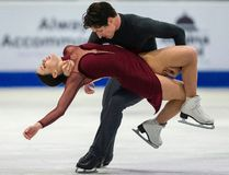 Tessa Virtue and Scott Moir of Canada perform their free dance on Saturday. (Geoff Robins / AFP / Getty Images)