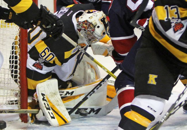 Despite the commotion around him, Kingston Frontenacs goalie Jeremy Helvig eyes the puck during the first period of Ontario Hockey League action at the Rogers K-Rock Centre on Sunday. (Steph Crosier/The Whig-Standard)