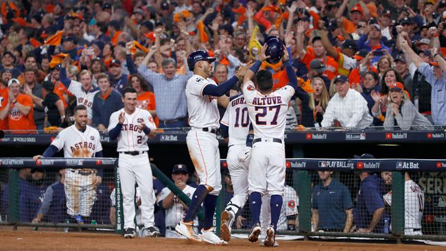 Yuli Gurriel #10 of the Houston Astros celebrates with Carlos Correa #1 and Jose Altuve #27 after hitting a three run home run during the fourth inning against the Los Angeles Dodgers in game five of the 2017 World Series at Minute Maid Park on October 29, 2017 in Houston, Texas. (Photo by Jamie Squire/Getty Images)