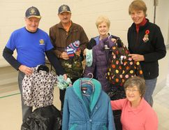 Rotarians (from left) Dave Nicolle, Dave Bradshaw, Donna Raytrowsky, Barb Billings and, kneeling, Bettyann Carty, hold some of the many coats that were part of the distribution process of Coats for Kids on Saturday at First Baptist Church in Simcoe. SUSAN GAMBLE/POSTMEDIA NEWS