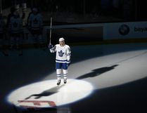 Toronto Maple Leafs centre Patrick Marleau raises his stick to the crowd as he is honored before an NHL hockey game against the San Jose Sharks, his former team, Monday, Oct. 30, 2017, in San Jose, Calif. (AP Photo/Marcio Jose Sanchez)