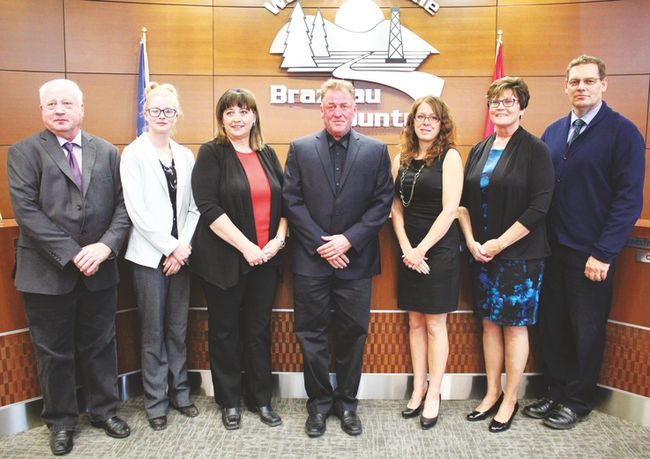 Pictured above are members of Brazeau County County Council, who were sworn into office on October 26: (l. to r.) Anthony Heinrich, Sarah Wheale, who is also a member of Premier Justin Trudeau's Youth Council, Heidi Swan, Reeve Bart Guyon, Kara Westerlund, Donna Wiltse and Marc Gressler. Much of the day was spent determining which councillors would sit on some five dozen boards and committees.