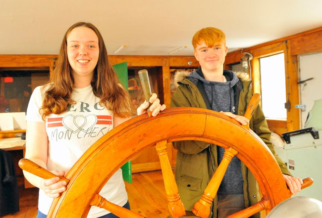 Holly Bailey and Ryan Ball take the wheel at the Port Dover Harbour Museum during a visit on Monday. The duo and six other students from Wales are currently touring Norfolk as part of the Rotary Club of Norfolk Sunrise/Rotary Club of Welshpool Wales student exchange. JACOB ROBINSON/Simcoe Reformer