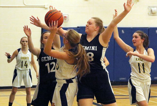 College Avenue Knights Megan Grevers, left, attempts a shot with Glendale Gemini's Megan Hill defending her during the TVRA senior girls' east division in Woodstock, Ont. on Tuesday October 31, 2017. CASS won 32-18 and are first place in the TVRA East Division. Greg Colgan/Woodstock Sentinel-Review/Postmedia Network