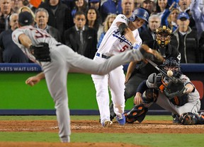 Los Angeles Dodgers' Corey Seager hits a sacrifice fly off Houston Astros starting pitcher Justin Verlander during the sixth inning of Game 6 of baseball's World Series Tuesday, Oct. 31, 2017, in Los Angeles. (AP Photo/Mark J. Terrill)