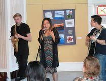 Sarnia's Cynthia Fay (centre) and bandmates Ben Rowley (sax) and Stephen Halsey (guitar) belt out an inspired cover of James Brown's classic 'I Got You (I Feel Good)' at the Lawrence House's House Concert Series on Oct. 22. CARL HNATYSHYN/SARNIA THIS WEEK