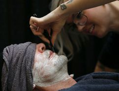 <p>A barber shaves Theo Fleury during Kick Off Movember at Best of Seven Barbers in Calgary, Alta., on Wednesday November 1, 2017. </p><p> Leah Hennel/Postmedia Network
