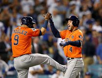 Houston Astros' George Springer (right) celebrates with Marwin Gonzalez after hitting a two-run home run during the second inning against the Los Angeles Dodgers in Game 7 of the 2017 World Series at Dodger Stadium on Nov. 1, 2017 in Los Angeles. (Ezra Shaw/Getty Images)