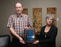 KEVIN RUSHWORTH HIGH RIVER TIMES/POSTMEDIA NETWORK. Darryl Peterson, president of the condo board for The View at Sunrise, and Gloria Lundberg, board secretary, hold up their award from the Canadian Condominium Institute.