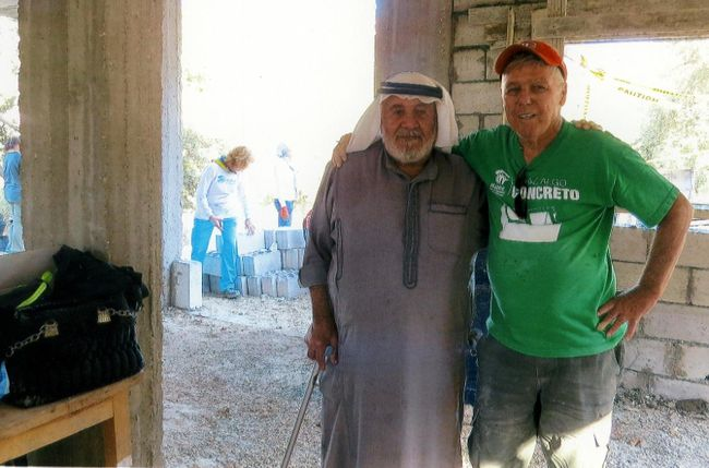 <p>Buck Buchanan with the grandfather of the children he was building  a house for in Jordan. This was Buchanan's fifth trip overseas to help Habitat for Humanity Global Village.</p><p>