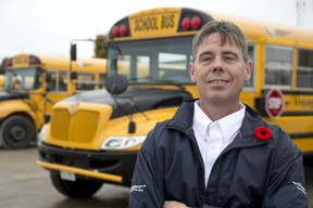 Jason Andress drives a school bus for Voyageur Transportation Services in London, which pays drivers $13 to $17 an hour. (DEREK RUTTAN, The London Free Press)