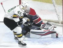 Saginaw Spirit goalie Evan Cormier gets enough of his left pad on the puck to deny a close-in chance by Knights forward Sam Miletic during the first period of their OHL game at Budweiser Gardens on Friday night. The Knights lost 6-5 in overtime. (MIKE HENSEN, The London Free Press)