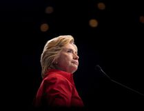 In this July 30, 2016 file photo, U.S. Democratic presidential candidate Hillary Clinton pauses while speaking at a rally in Pittsburgh during a bus tour through the rust belt. (Andrew Harnik/AP Photo/Files)