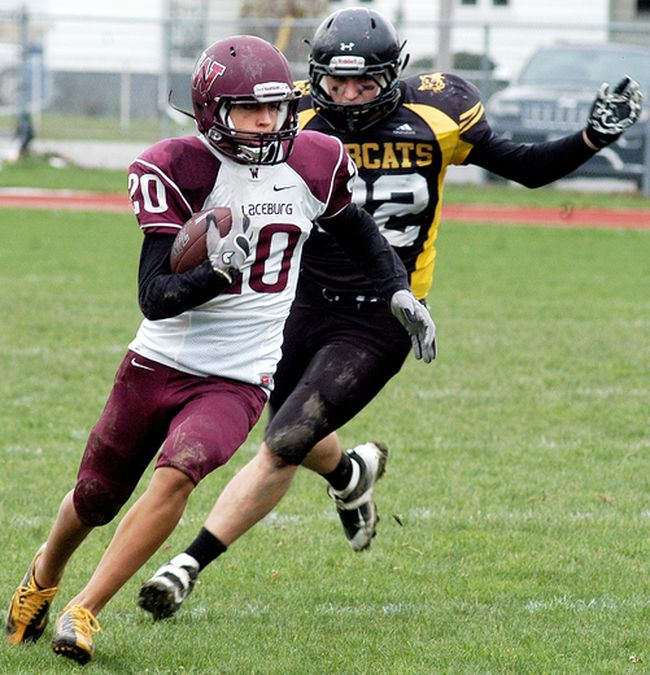 Wallaceburg Tartans' Brody Genyn (20) is pursued by a Blenheim Bobcat during the LKSSAA varsity senior football final at Wallaceburg District Secondary School on Saturday, Nov. 4, 2017. (DAVID GOUGH/Postmedia Network)