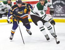 Hockey action between the Drayton Valley Thunder and the Ft. McMurray Oil Barons