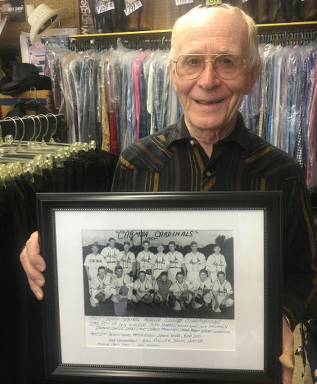 Larry Stout, who wrote this piece to commemorate the 60th anniversary of the occasion, holds a photo of the 1957 South Central Border League Champions. Back row, left to right: Don Walker, John Murray (playing coach), Jim McIntosh, Raymond Ganske, Larry Stout, Charlie McCullough, Frank Arnett, Wayne Sylvester. Front row, left to right: Dennis Woods, Armin Gitzel, Ernie Woods, Bob Lees, Fred Vankoughnet, Bill Fuller, Dennis Hunter. Missing from photo: Phil Bottrel. (EMILY DISTEFANO)