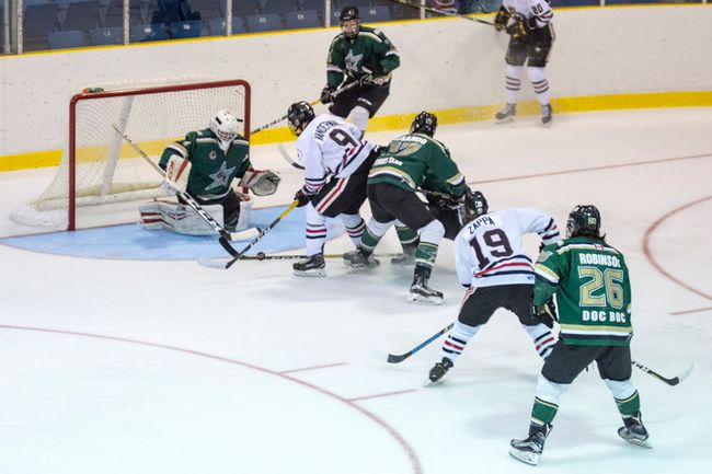 Sarnia Legionnaires forwards Zac Vanderwal (No. 9 in white) and Joey Zappa (No. 19) storm the St. Thomas Stars net in this photo taken the last time the two teams faced off at Sarnia Arena. The clubs will square off again Thursday at the same location. (Photo courtesy of Shawna Lavoie)