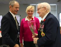 Morden mayor Ken Wiebe and wife Linda handed out roses to veterans to honour their service. (LAUREN MACGILL, Morden Times)