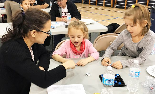 Jennifer Roy (left) and her daughter Sarah (Middle) along with Destiny Deerlove, all taking part in some math games as part of LVS' Math Residency Tuesday night. (Aaron Wilgosh/The Graphic)