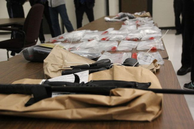 Weapons and cash seized during an arrest in the parking lot of a city bank Oct. 31.