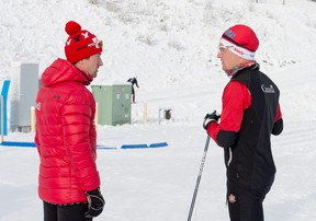 Ivan Babikov, World Cup team coach, talks to Knute Johnsgaard, on the men's national cross-country ski team, races at the Frozen Thunder sprints at the Canmore Nordic Centre on Wednesday, November 1, 2017. photo by Pam Doyle/www.pamdoylephoto.com