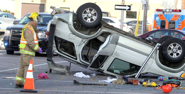 Firefighters respond to a two-vehicle collision at Bay and Elgin streets at about 12:20 p.m. on Wednesday.