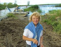 Nancy Vidler, with the Lambton Shore Phragmites Community Group, is shown in this file photo at a project to battle the invasive weed in a wetland next to Lake Huron. A pilot project has been proposed that would see the St. Clair Region Conservation Authority take on a coordinating role in the local fight against phragmites.
