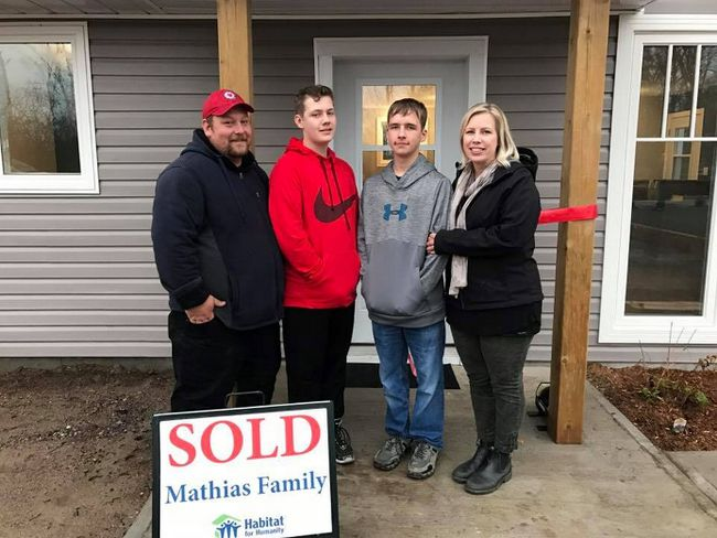 The Mathias Family, from left, James, Dylan, Joseph and Rachel, will be able to move into their Habitat for Humanity home in Roblin by the end of November. The family received a ceremonial key and other gifts on Nov. 2. (HABITAT KINGSTON/Supplied Photo)