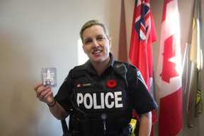 Const. Tanya Calvert holds up Narcan nasal spray, an antidote to an opioid overdose. Each St. Thomas police officer will be carrying them while on duty within the week. (Laura Broadley/Times-Journal)