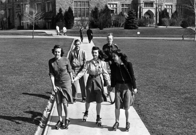 As the Second World War intensified, gasoline rationing forced students to abandon their cars and seek alternate transportation. Coeds Ruth Johnson (left), Peggy Lang and Mary Scott were typical of the many who adopted roller skates to get around campus. In the background (left) is Leo La Fontcini also on skates and Kenrick Gunn whose shiny new bicycle replaced the car he drove daily to campus. (The London Free Press Collection of Photographic Negatives, Western Archives, Western University)