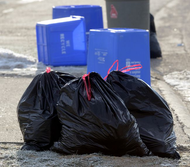 Bags of garbage wait to be picked up. MORRIS LAMONT/POSTMEDIA NETWORK