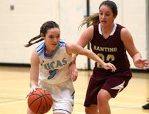 Melanie Plaske of Lucas drives past Eme Robinson of Banting during their TVRA Central final at Lucas on Thursday November 9, 2017. Vikings started out hot, hitting everthing while Banting was ice cold from the floor, and it showed on the board as Lucas streaked out to a 21-5 lead in the first quarter and then cruised to an easy 55-33 win. Lucas will face CCH next week in WOSSAA for a chance to return to OFSAA. Mike Hensen/The London Free Press/Postmedia Network