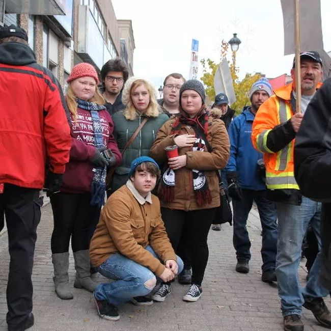 Canadore students join the picket line Wednesday afternoon outside Nipissing MPP Vic Fedeli's office on Main Street.