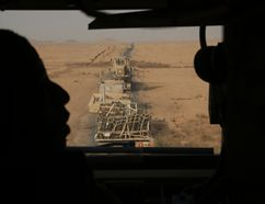 In this Monday, Nov. 6, 2017 photo, U.S. Marines transport equipment and ammunition in Anbar, Iraq. The US-led coalition's newest outpost in the fight against the Islamic State group is in this dusty corner of western Iraq near the border with Syria where several hundred American Marines operate close to the battlefront, a key factor in the recent series of swift victories against the extremists. (AP Photo/Khalid Mohammed)