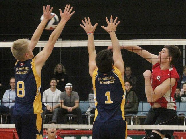 St. Mike's players Connor Meiering (8) and Joe Yundt (1) attempt to block Stratford Central's Ben Newell during the Huron-Perth senior boys volleyball final Thursday at Central. The Rams won in straight sets. (Cory Smith/The Beacon Herald)