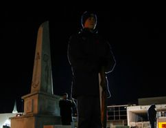 Luke Hendry/The Intelligencer Flight Sgt. J.D. Comegys of 704 Royal Canadian Air Cadet Squadron stands guard at the Trenton cenotaph Friday in Trenton. The ninth-annual vigil, held next to Royal Canadian Legion Branch 110, included a brief service, the placing of candles and a 24-hour vigil by local cadets from several units who rotated in half-hour shifts throughout the frigid night.