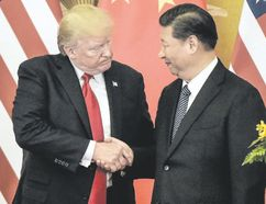 U.S. President Donald Trump presses palms with China's President Xi Jinping at the end of a press conference in Beijing on Thursday. (FRED DUFOUR/AFP/Getty Images)