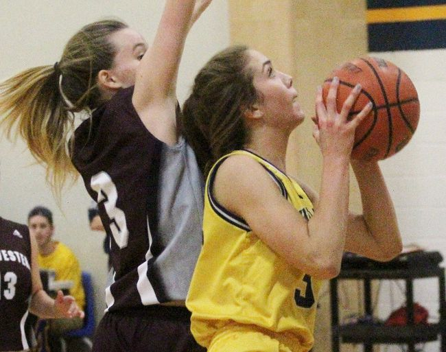 Northwestern's Morgan Goffar tries to chase down St. Mike's Kathryn Simmons during the senior girls basketball final Friday at St. Mike's. The Warriors won 54-35. (Cory Smith/The Beacon Herald)