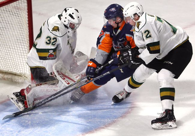 Knights goalie Joseph Raaymakers holds his ground as Jack Wismer of the Flint Firebirds drives the crease while being guarded by London defenceman Alec Regula during the first period of their OHL game at Budweiser Gardens on Friday night. Raaymakers made 32 saves for the shutout in a 9-0 rout. (MIKE HENSEN, The London Free Press)