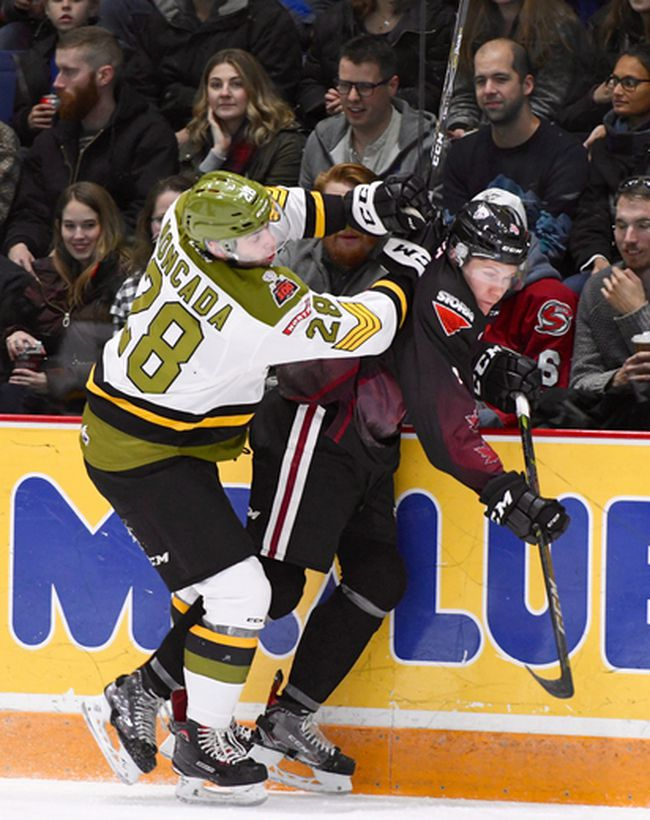 Luke Moncada of the North Bay Battalion battles the Guelph Storm's Owen Lalonde in first-period action of their Ontario Hockey League game Friday night at the Sleeman Centre. The Troops, who wrapped up a run of six consecutive road games, entertain the Niagara IceDogs at 2 p.m. Sunday on Military Appreciation Day at Memorial Gardens.